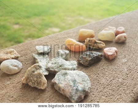 many different types of stones on a composite deck railing