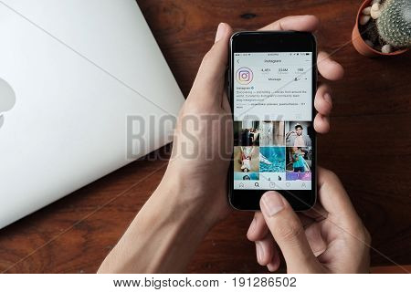 CHIANG MAI THAILAND - JUN 152017: A man holds Apple iPhone with Instagram application on the screen. Instagram is a photo-sharing app for smartphones.