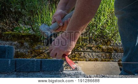 bricklayer tools man working on construction site hammering chisel