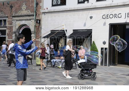 Copenhagen /Denmark - 15.June 2017. Male makes soap bubbles o stroeget . (Photo.Francis Joseph Dean/Deanpictures)