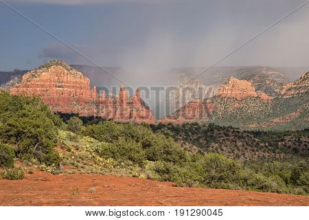 a monsoon storm over the scenic red rock landscape of Sedona Arizona