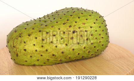 Soursop, Prickly Custard Apple, Annona muricata L on wooden cutting board.