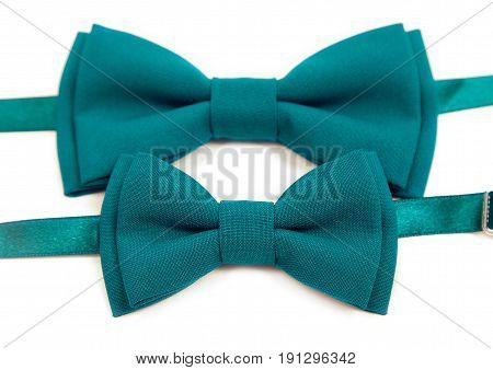 Green bow tie lies on a white table, two bow ties, tie green. Mens Tie, for groom and his younger brother.