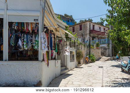AGIOS NIKITAS, LEFKADA, GREECE JULY 16, 2014: Traditional houses in village of Agios Nikitas, Lefkada, Ionian Islands, Greece