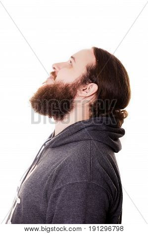 Touching his perfect beard. Close-up of young bearded man touching his beard while standing against grey background.