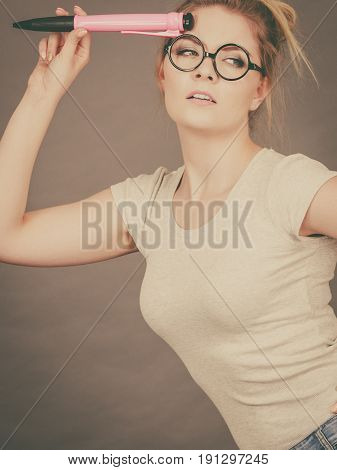 Woman Holding Big Oversized Pencil Thinking About Something
