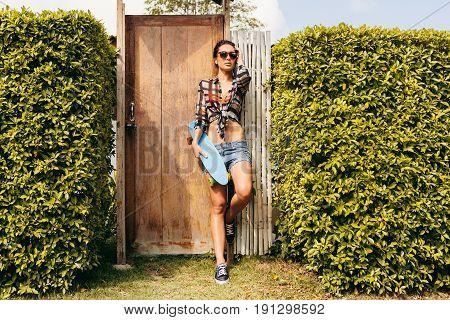Pretty Girl With Skateboars Near Her House.