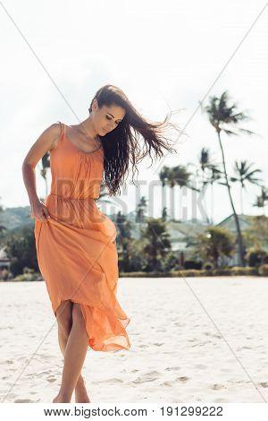 Pretty Girl In Summer Dress On The Beach.