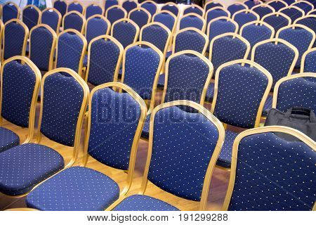 Empty conference chairs in row at a business room. Comfortable seats in empty corporate meeting office for presentation