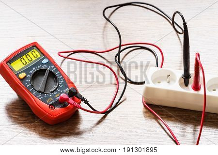Measurement Voltage In Electrical Socket With Multimeter