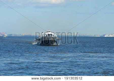 The hydrofoil boat travels along the Gulf of Finland on a sunny May day, Saint-Petersburg