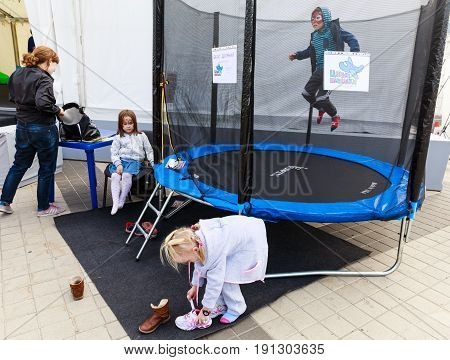 Funny Kids Playing And Jumping On A Outdoor Trampoline