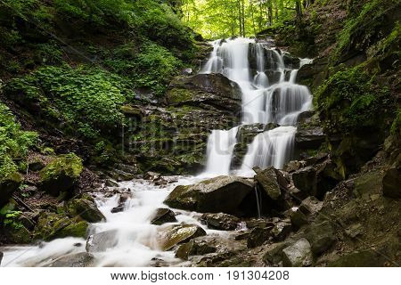 Waterfall Shipot on the mountain river in the gorge among the stones. Carpathians. Ukraine