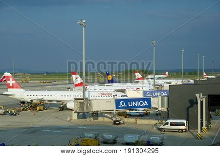 VIENNA, AUSTRIA - APR 30th, 2017: Airplanes of Austrian Airlines, SWISS and Lufthansa parked at the gates in Vienna International Airport. It is the countrys biggest airport, it serves as the hub for Austrian Airlines. Picture was taken from the Austrian