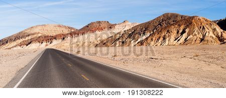 Beautiful day clear blue skies and open road in Death Valley