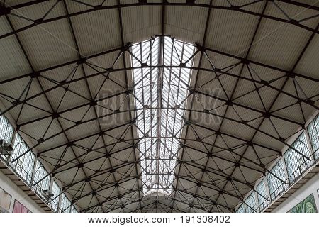 The roof, dome and ceiling of an old building covered market. Russia, city of Saratov