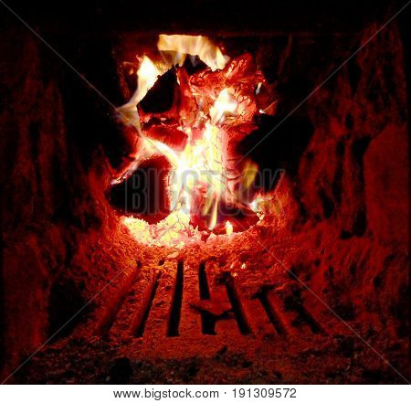 Photo of fire brown wood dark grey black coals on bright yellow fire inside metal brazier.Wood burning in the braziers.Flames fires preparation for cooking barbecue. Brazier of nature bbq background.