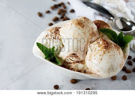 Balls Of Cream Ice Cream With Chocolate, Mint And Coffee In A Cup On A Marble Kitchen Table.