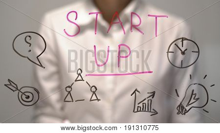 concept. Woman wrote Start Up on transparent screen. Businesswoman write on board. Start Up concept