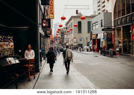 MELBOURNE, AUSTRALIA - March 11, 2017: Main street in the popular neighborhood of Chinatown in Melbourne, Australia.