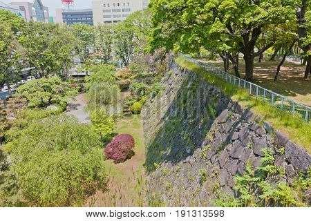 MARIOKA JAPAN - MAY 22 2017: Stone walls (ishigaki) of former Marioka castle constructed in 1633 and dismantled in 19th c. Today is National Historic Site of Japan and part of Iwate Park