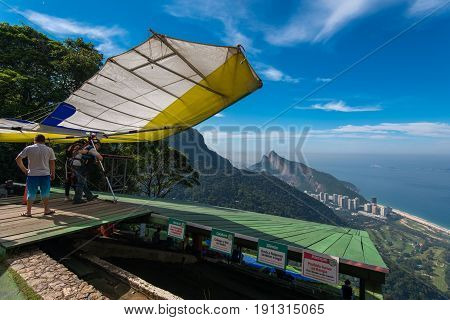 Rio de Janeiro, Brazil - June 7, 2017: A hang glider prepares to take off from the upper ramp at Pedra Bonita, in the Tijuca National Forest, on a trip to the beach at São Conrado.
