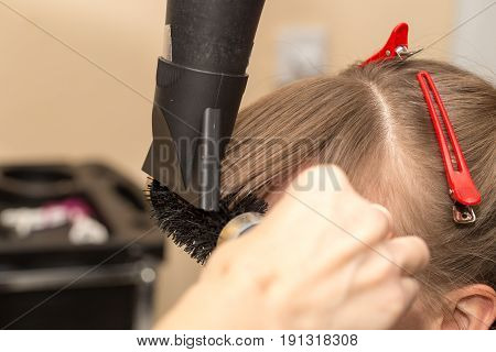 blow-drying in a beauty salon . A photo