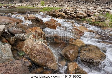 Water flowing over rocks. Large rocks in Canyon Creek a few miles from Wallace Idaho.