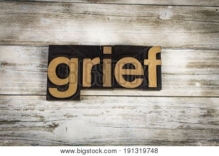 Grief Letterpress Word On Wooden Background