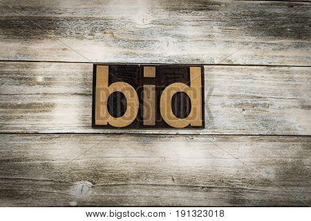 Bid Letterpress Word On Wooden Background