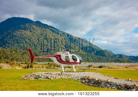 SOUTH ISLAND, NEW ZEALAND- MAY 25, 2017: A helicopter ready to take tourists to a glacier in the South Island of New Zealand.