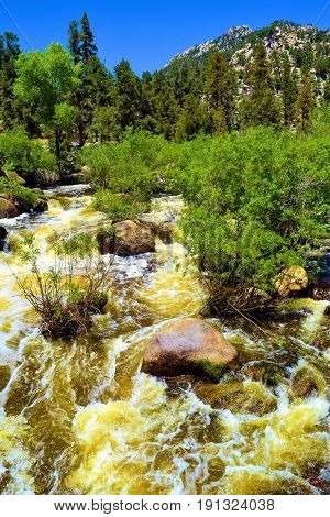 Roaring river rapids from snowmelt during spring taken at the Kern River in the Sierra Nevada Mountains, CA