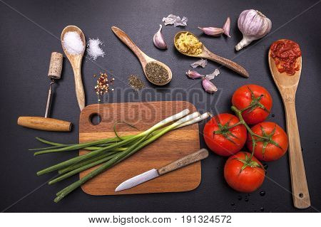 various ingredients and utensils for cooking in a concept photo.