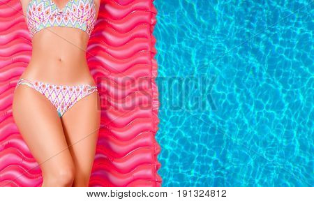 Woman In Bikini On The Inflatable Mattress In The Swimming Pool.