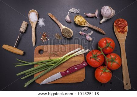 Ingredients and utensils for cooking. Assorted vegetables spices and utensils in a concept photo.
