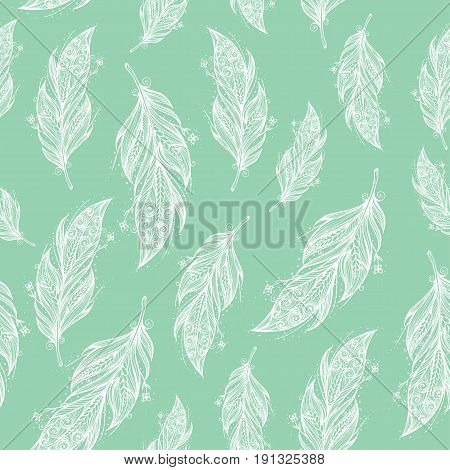 seamless pattern with white feathers on light blue background