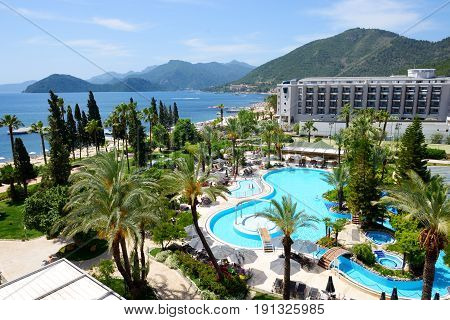 MARMARIS TURKEY - MAY 20: The tourists enjoing their vacation in luxury hotel on May 20 2013 in Marmaris Turkey. More then 36 mln tourists have visited Turkey in year 2013