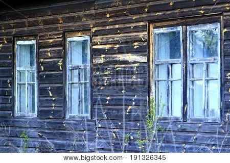 The windows of the old rural wooden house