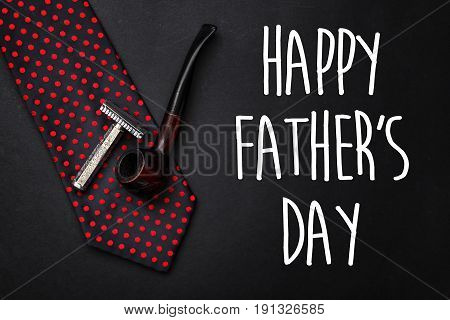 Happy Father's Day Text Sign. Fathers Day Greeting Card. Classic Tie With Wooden Tobacco Pipe And Ra