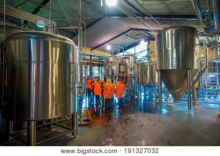 SOUTH ISLAND, NEW ZEALAND- MAY 25, 2017: Modern beer plant brewery , with brewing kettles, vessels, tubs and pipes made of stainless steel, monteiths beer factory, south island in New Zealand.