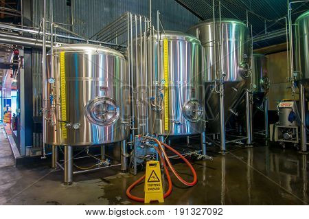 SOUTH ISLAND, NEW ZEALAND- MAY 25, 2017: Modern Beer Factory, steel tanks for beer fermentation and maturation, monteiths beer factory, south island in New Zealand.