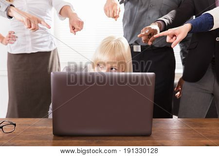 Many Hands Pointing The Stress Business Woman At The Workplace