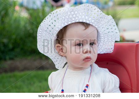 An Infant Toddler Girl dressed as Betsy Ross for Fourth of July Parade