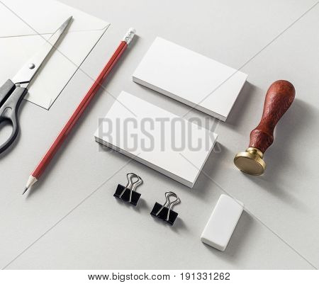 Photo of blank stationery set on paper background. Responsive design mock-up for placing your design. ID template. Top view.