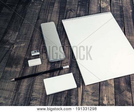 Blank stationery set on vintage wood background. Template with plenty of copy space for placing your design. Responsive design mock up.
