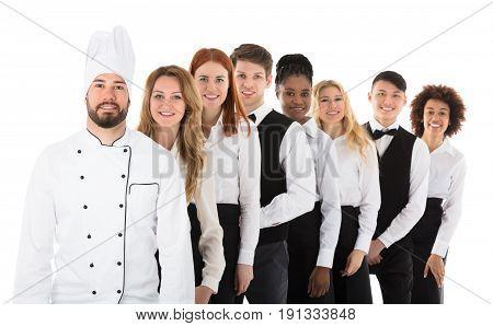 Portrait Of Happy Restaurant Staff Standing In Row