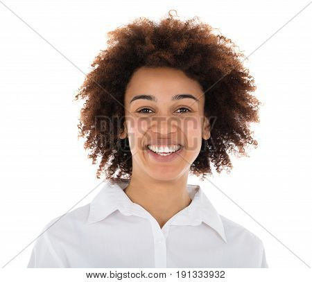 Portrait Of A Smiling Hostess Standing In Front Of White Background