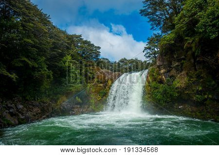 Water from volcano Mt Ruapehu forms Tawhai Falls in Tongariro National Park, New Zealand.