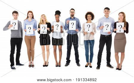 Group Of Happy College Students With Question Mark Sign Standing On White Background