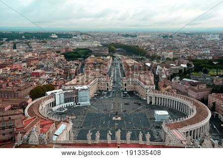 Vatican City,Rome Italy.November 5th 2013.The largest church on earth is a must see when in Rome.Here St. Peters square as seen from atop of Michelangelo's dome,also makes for a great view of Rome itself.Bernini's masterpiece of the square along with the